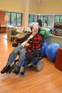 A Beechwood client smiles as he prepares for physical therapy.