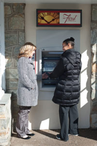 A Beechwood client completes a transaction at an ATM.