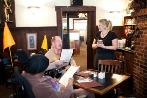 Two Beechwood clients dine at a local restaurant.
