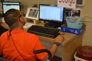 A member of the Beechwood communications work unit works on the computer.