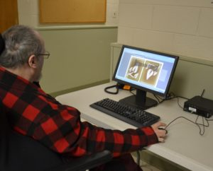 A Beechwood client works on the computer.