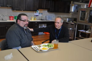 A Beechwood client enjoys a meal he helped prepare.