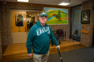 A Clubhouse member strolls through the Stabler NeuroRehab Center at Beechwood NeuroRehab.
